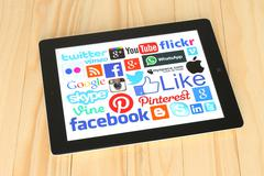 Collection of popular social media logos on iPad screen - stock photo