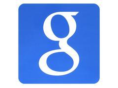 Google logotype printed on paper on white background Stock Photos