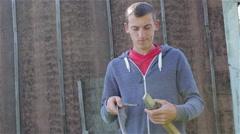 Farmer with scythe Stock Footage