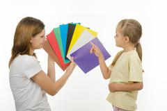 The child learns to identify colors - stock photo