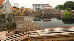 Treatment facilities and Ciliwung river bridge from under old watchtower Stock Footage