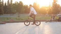 BMX bike trick 360 sunset - stock footage