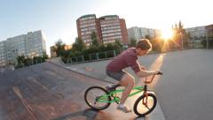 slow motion: Extreme Sport skatepark BMX bike trick can-can - stock footage