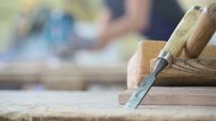 Carpenter working on piece of wood with sawing machine Stock Footage