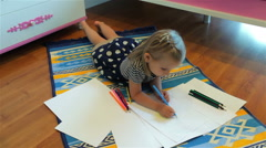 Cute little girl drawing. Elementary age. Stock Footage