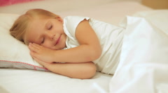 Adorable little girl sleep in the bed Stock Footage