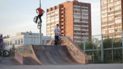 slow motion: Extreme Sport skatepark BMX bike trick no hand - stock footage