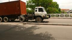 Truck with 20ft steel container drive across bridge, tracking shot Stock Footage