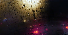 View of city through wet and weepeing car window Stock Footage