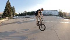 BMX bike Barspin 180 trick - stock footage