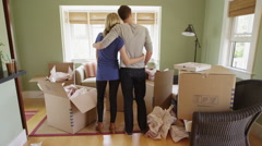 Young couple standing in their new apartment Stock Footage
