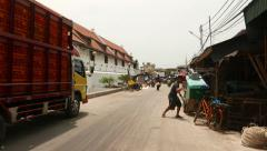 Short walk on Pasar Ikan street against Museum Bahari, glide shot Stock Footage