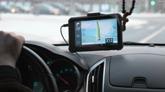 Driving a car with GPS device over dashboard Stock Footage