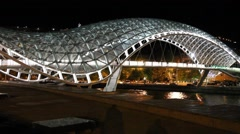 Night view of the brightly lit bridges of Peace Stock Footage