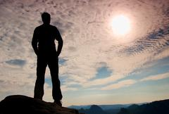 Stock Photo of Hiker stand on the sharp corner of sandstone rock in rock empires park and wa