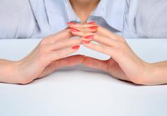 Woman hands protect something - stock photo
