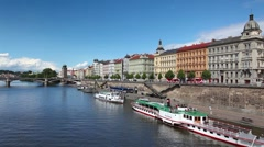 Tourist boat floating on the Vltava river before storm. Stock Footage