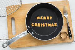 Cookie biscuits word MERRY CHRISTMAS in frying pan Stock Photos