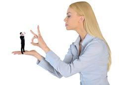 Business woman finger flipping on little man Stock Photos