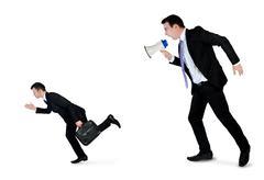Business man screaming on megaphone Stock Photos