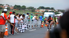 Cycling Event - bike racers under finish line - Bauru, Sao Paulo, Brazil.  Stock Footage