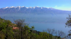 The peaks of the Alps as seen from Tignale, Lake Garda, Italy Stock Footage