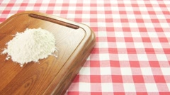 Ingredients to prepare pizza on white red square tablecloth dolly shot Stock Footage