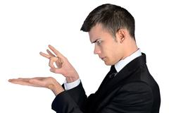Business man finger flick - stock photo