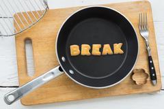 Alphabet crackers word BREAK putting in pan Stock Photos