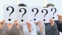 Business team behind question marks Stock Footage