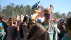Color fest guy jumping on a trampoline Stock Footage