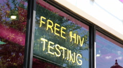 Tilt on Free HIV Testing Sign in Dallas Texas Stock Footage