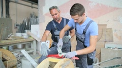 Teenager with professional brick layer in training school - stock footage