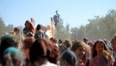 Slow motion color fest Holi guy jumping on a trampoline Stock Footage