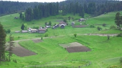 Old neighborhood of wooden houses in mountain Stock Footage