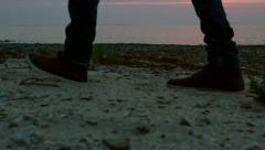 Slow motion man's footsteps toward the dawn slider shot Stock Footage