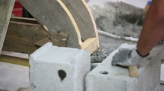 Closeup of mason's hand building concrete structure - stock footage
