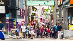 People walk and shop along the Takeshita Street in Harajuku, Tokyo, Stock Footage