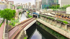 Time-lapse of multiple train lines in Tokyo at dusk Stock Footage