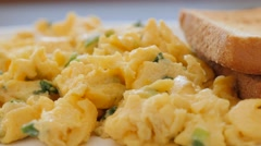 Scallion toasted bread  and beaten eggs fried on plate 4K 2160p UltraHD foota Stock Footage