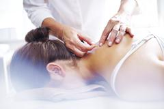 Acupuncturist applying acupuncture needles to woman's neck Stock Photos