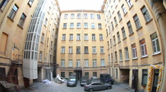 Quadrangle small inner yard of residential house with car parking area, Russia Stock Footage
