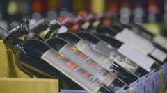 wine bottles stacked on wooden racks - stock footage