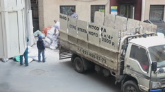 People load construction debris in small lorry body. Recycling of garbage Arkistovideo