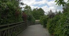 Wooden Bridge Through The Green Park, Wooden Fense Stock Footage