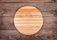 Cutting board on old table Stock Photos