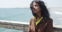 Attractive black woman enjoying the ocean air Stock Footage