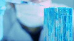 scientist working into a laboratory: researcher in biochemical lab - stock footage
