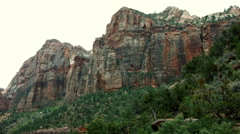 MOUNTAIN CLIFFS TOWER OVER THE VALLEY BELOW Stock Footage