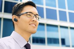 Business Man With Bluetooth Handsfree Device Text Space Stock Photos